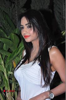 Actress Model Pooja Sri Stills in White Short Dress at F Club pre soft Launch  0043.JPG