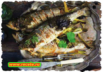 Whole grilled fish with lemon-paprika oil
