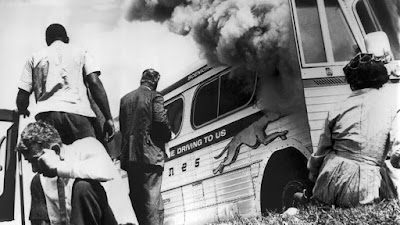 Greyhound bus full of Freedom Riders is bombed outside Anniston, Alabama (photo, Joe Postiglione)