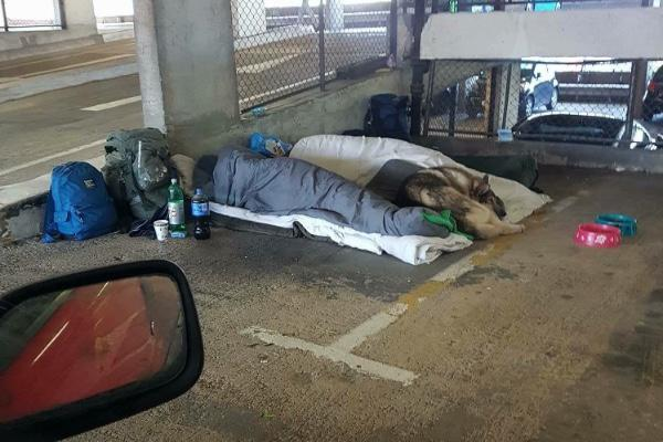 Homeless men and their dog found living rough in a car park are mocked by cruel jibes – until a kind-hearted stranger stepped in to help
