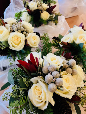 Photo of bridesmaid bouquets made of winter flowers and white roses