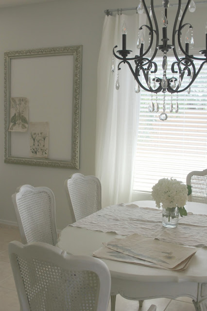 Shabby chic white cane back dining chairs and table by Hello Lovely Studio