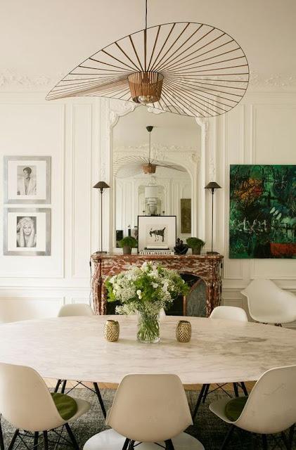 dining room with modern chairs and vertigo pendant
