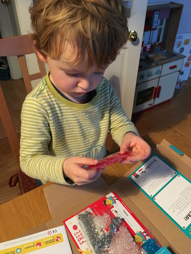 toucanBox-Subscription-Box-review-toddler-with-beads-from-the-box