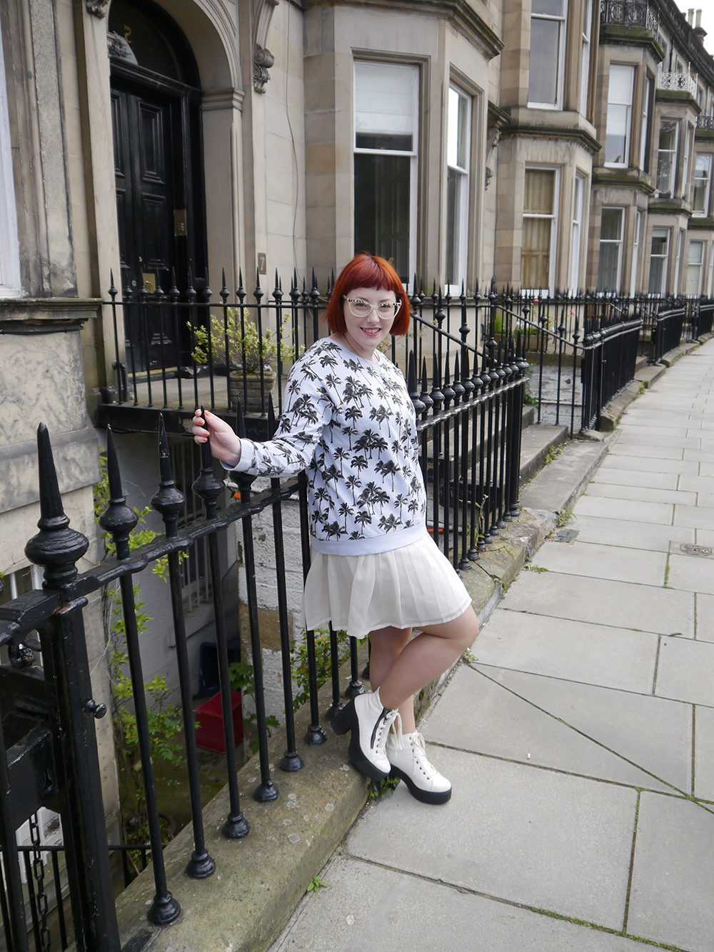 Scottish blogger, Edinburgh blogger, Scottish street style, quirky street style, dressing to a theme, food inspired outfit, pale girl style, Spex Pistols glasses, red head, red hair, H&M, patterned jumper, palm tree sweatshirt, white pleated dress, white boots, lace up shoes, milk necklace, Tiny Treat Boutique necklace, milk bottle jewellery, Lucky Dip Club