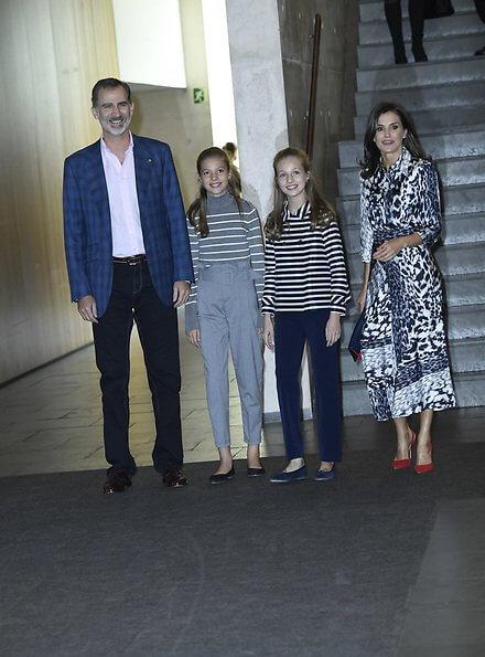 Queen Letizia wore a leopard-print silk blouse and midi skirt by Victoria Beckham. Crown Princess Leonor, Carolina Herrera