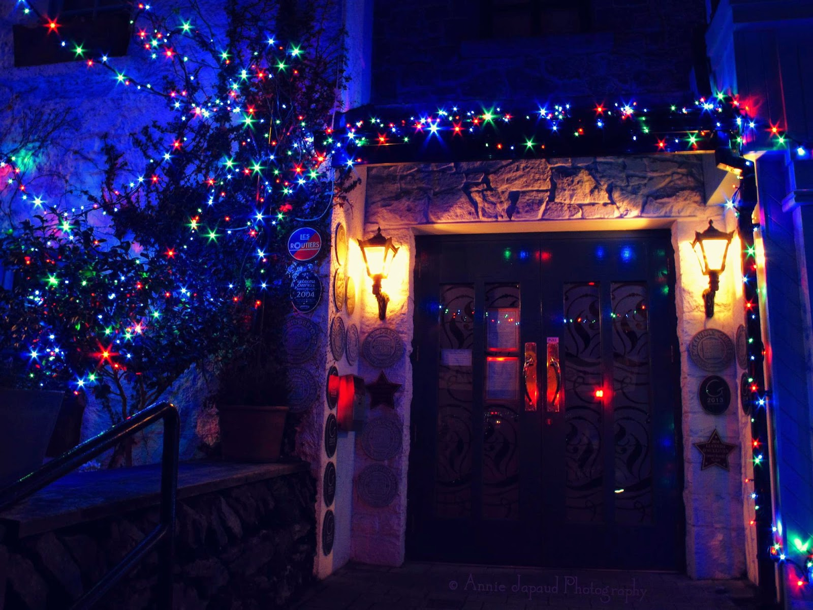 the entrance of the White Gable surrounded with Christmas Lights