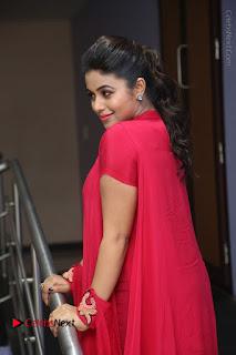 Actress Poorna Latest Stills in Red Dress at Rakshasi First Look Launch  0196.JPG