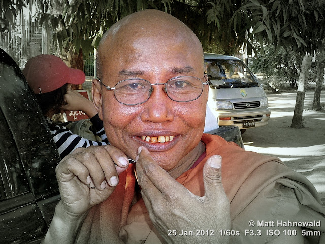 Burma, Myanmar, Bagan, Burmese man, Burmese monk, Buddhist monk pulling out his facial hair, people, street portrait, focal black and white