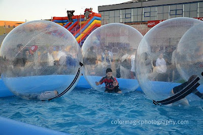Kids in water walking balls