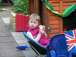 party confusion small child in blue chair