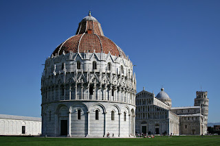 The Campo dei Miracoli in Pisa, with the baptistery in the foreground and the Leaning Tower beyond the cathedral
