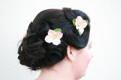 Bride with vintage pin curls and flowers in her wedding hair