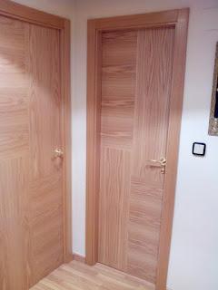 Puertas de diseño en madera y chapas de roble barnizadas a medida por carpintero Zaragoza