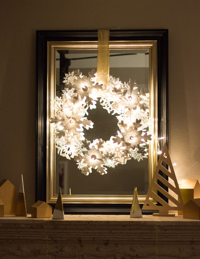 Make this glowing snowflake wreath out of inexpensive ornaments!