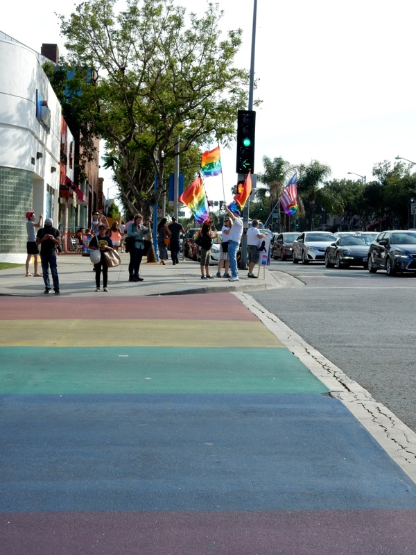 Rainbow crossing Pride flags West Hollywood