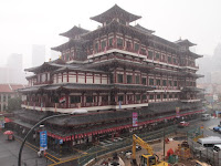The Buddha Tooth Temple in the rain