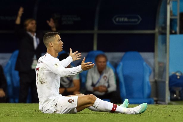 Why does Cristiano Ronaldo wear long sleeve shirts when he plays for  Portugal and Real Madrid  47d1eee54