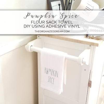 DIY pumpkin spice flour sack towel using adhesive vinyl.