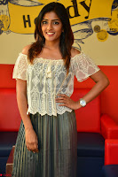 Eesha in a cute deep neck top and Skirt at at Big FM 075.JPG