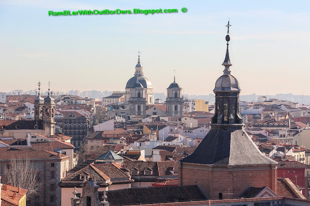 , Almudena Cathedral, Madrid, Spain Close-up of some of the church buildings. The closest church in the foreground is Iglesia del Sacramento (Church of the Sacrament ). It's a military church., Almudena Cathedral, Madrid, Spain