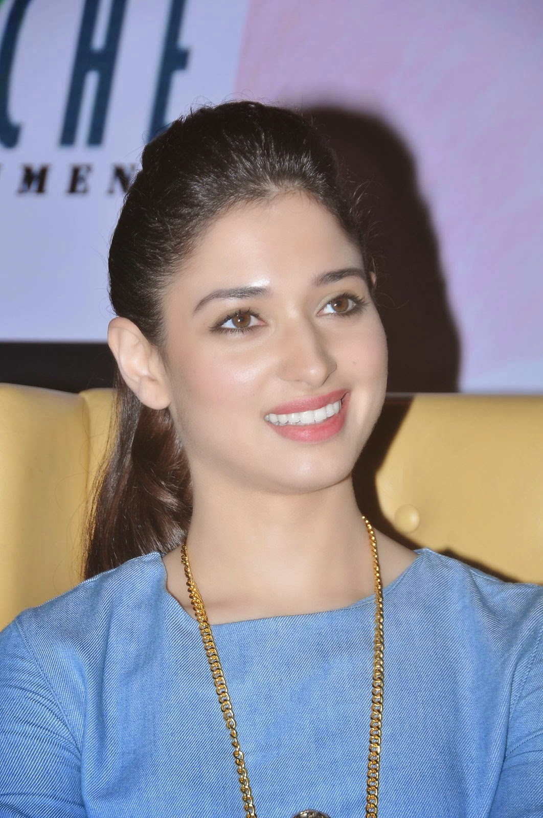 Tamannaah Bhatia Smiling Teeth Photos In Blue Top