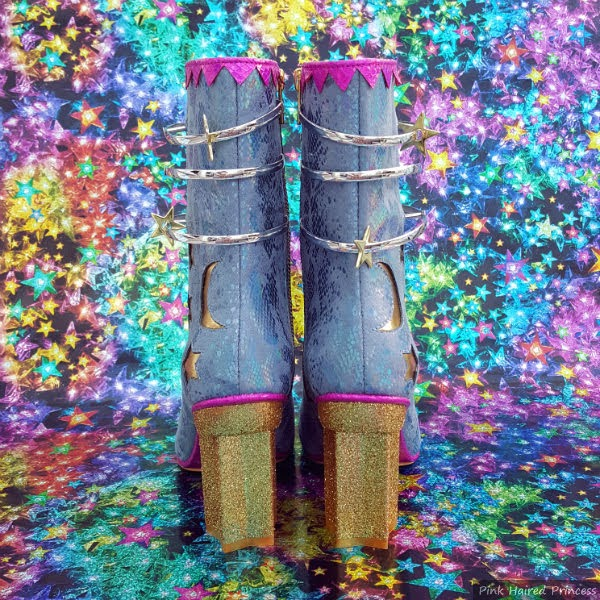 back view of boots with gold glitter star shaped heels and blue uppers