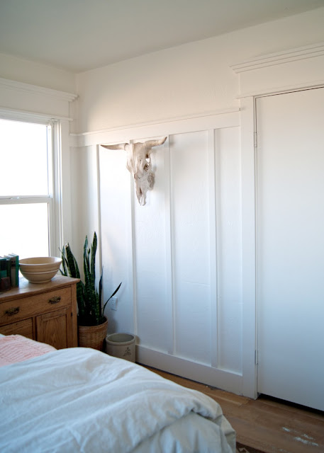 Farmhouse Master Bedroom Reveal - painted BM Simply White - cow skull