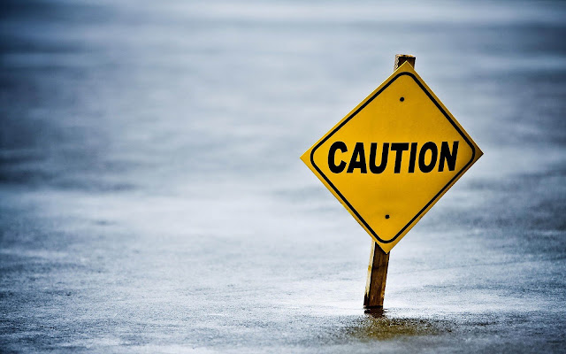 Bord met de melding voorzichtig dun ijs