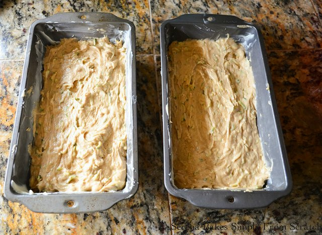 Zucchini Bread With Brown Sugar Crumb divide batter between pans from Serena Bakes Simply From Scratch.