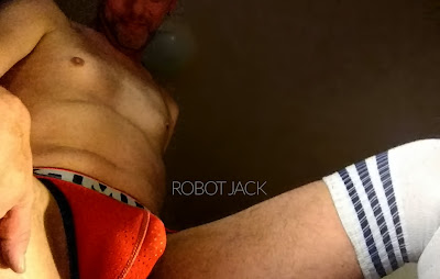 Robot Jack wearing Pump! jockstrap and thigh-high socks shows his cock bulge