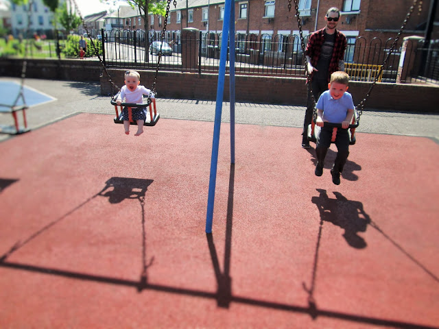Project 365 - D and Baby S smiling on the swing with Simon in the background pushing D