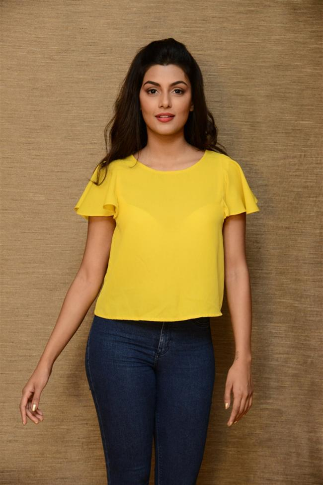 South Indian Actress Anisha Ambrose New Pics In Yellow Top Jeans