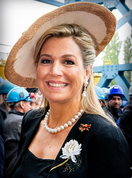 Queen Maxima wore Matthijs van Bergen Coppens Lelies jacket and floral print skirt