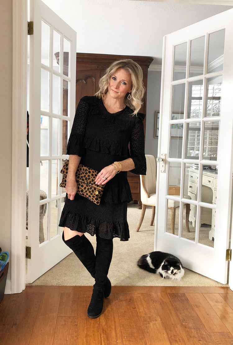 black lace dress with over the knee boots and a leopard clutch
