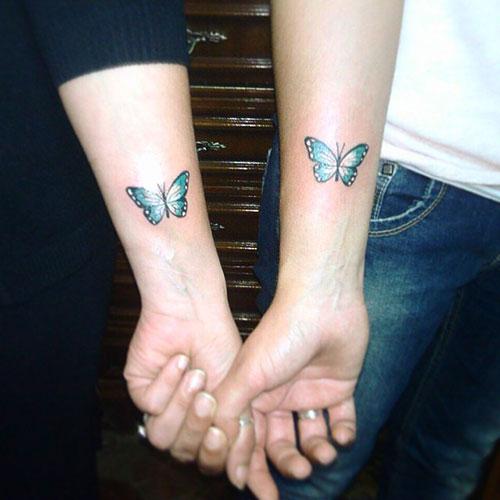 Casal Tatuagem de Borboleta no Braço
