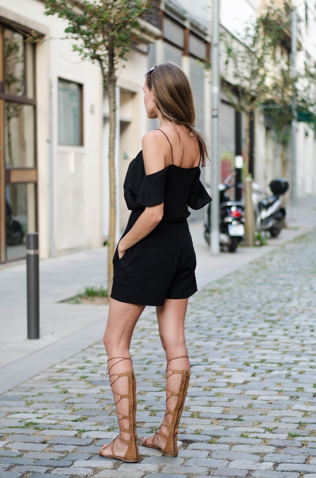 black off shouder top black shorts gladiator sandals summer outfit