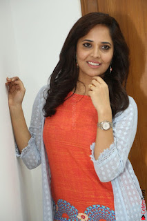 Actress Anasuya Bharadwaj in Orange Short Dress Glam Pics at Winner Movie Press Meet February 2017 (63).JPG