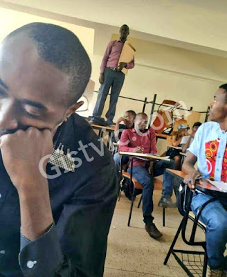 Male Lecturer Stands On A Table To Invigilate During Exam In A Private University