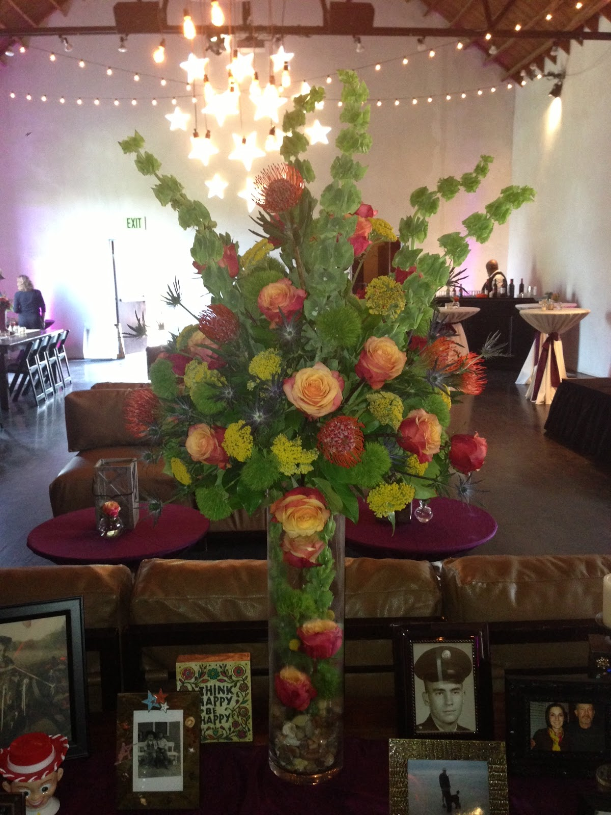 Table Decoration Ideas For Retirement Party used this as a centerpiece at a co workers retirement party using Green Ball Dianthus Pincushion Protea For The Cactus Element And Yarrow In The Large Entryway Arrangement And Billy Balls For The Table Centerpieces