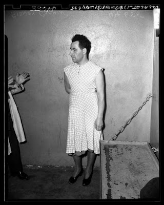 Wearing a dress in a Los Angeles jail, circa 1945