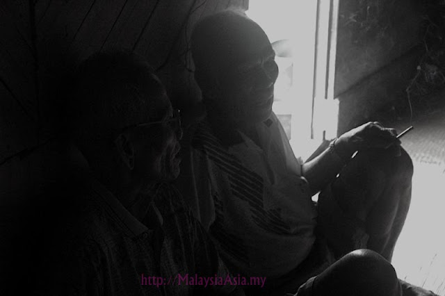 Photo of Iban elderly men smoking