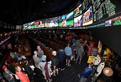 Showing People in Sports Betting Market with Large Screens like Stock Markets