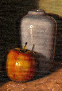 Oil painting of a red apple with a plain white porcelain vase.