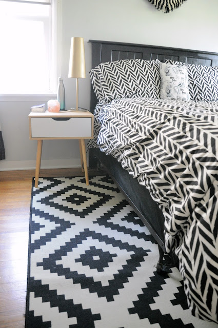 Teenaged Girl's bed with bottom mattress covered with fitted sheet