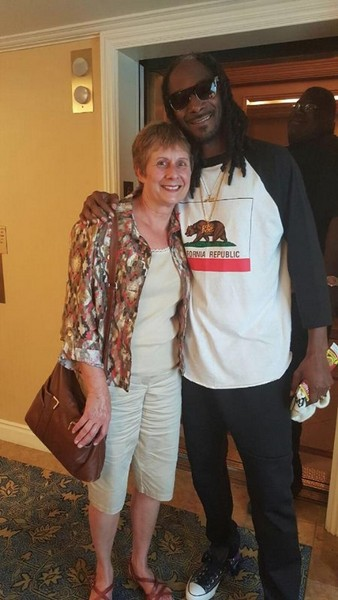 Snoop Dogg and Ginny Prior by the elevator at The Fairmont San Jose in California