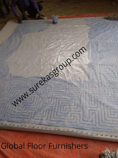 image trace being put on canvas cloth for weaving of hand-tufted rug