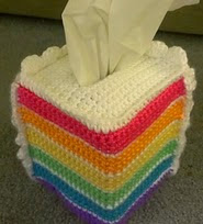 http://www.ravelry.com/patterns/library/rainbow-cake-tissue-cozy