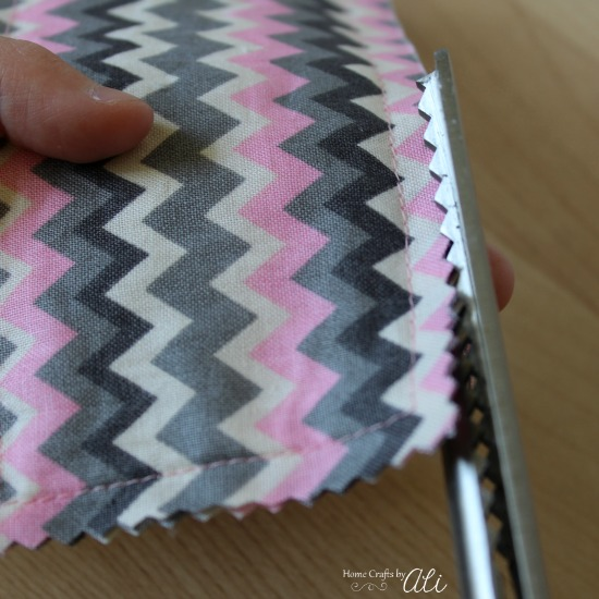 Trim edges of fabric bookmark with pinking shears