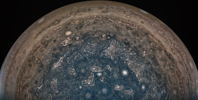 NASA's Juno spacecraft soared directly over Jupiter's south pole when JunoCam acquired this image on Feb. 2, 2017, from an altitude of about 62,800 miles (101,000 kilometers) above the cloud tops. This image was processed by citizen scientist John Landino. This enhanced color version highlights the bright high clouds and numerous meandering oval storms. Credits: NASA/JPL-Caltech/SwRI/MSSS/John Landino